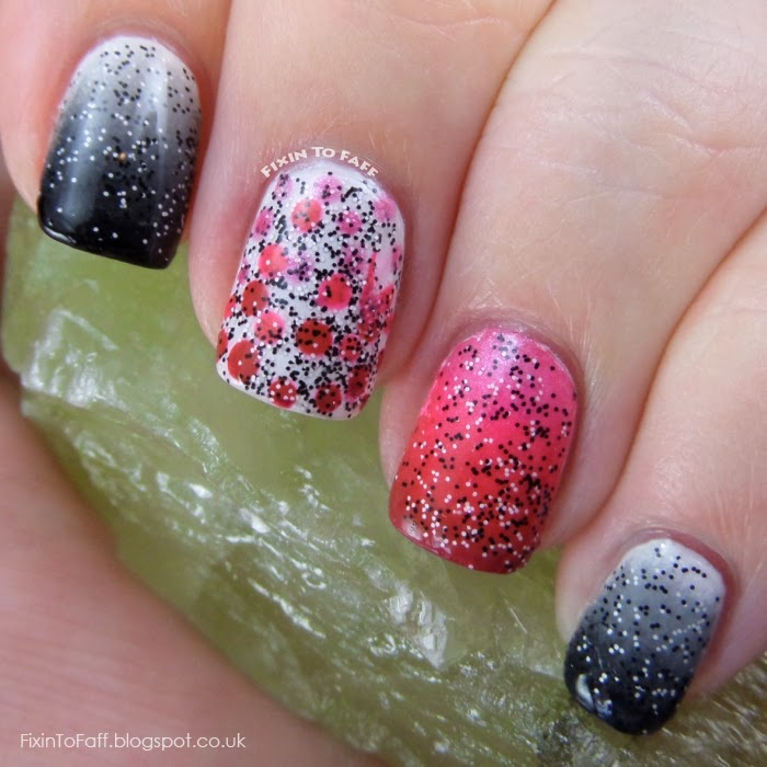 Gradiated mani in shades of black, grey, and white, and three different pinks, with a dotted gradient accent and black and white confetti glitter.