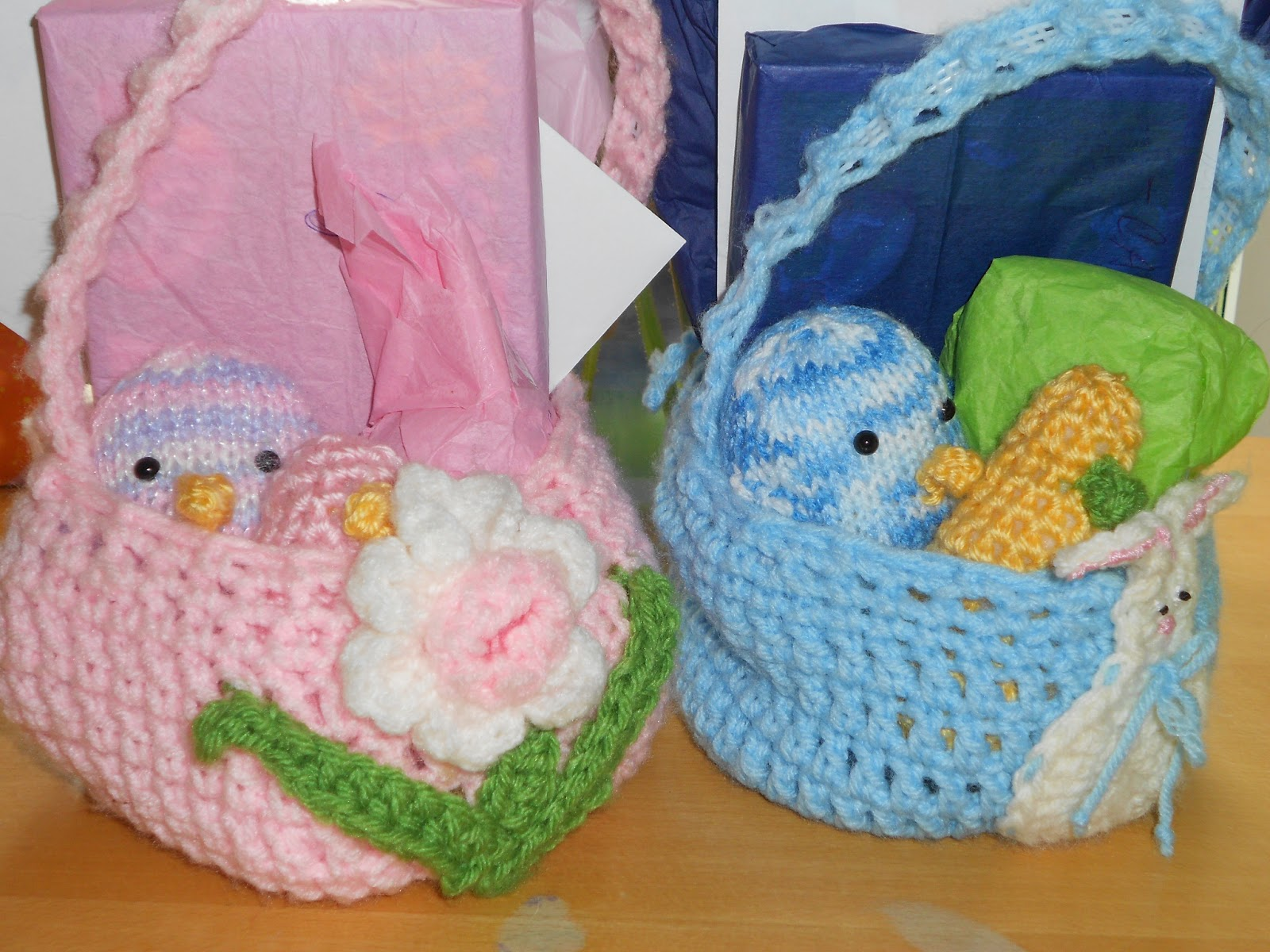 Crochet Easter Basket : On blue basket is a bunny, flower on pink basket.