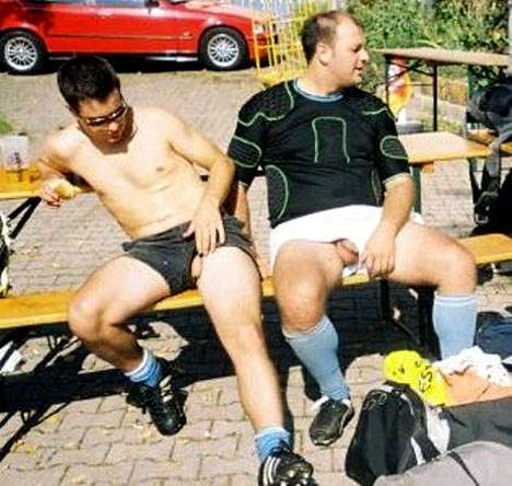 young-cock-hanging-out-of-shorts