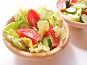 A bowl of salad - a small bowl of salad with lettuce, cucumber and tomatoes. Stock Photo Credit: kuwashima