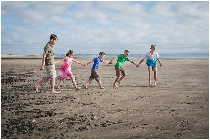 Children walking along the sand in North Devon