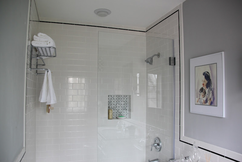 We used 3x6 white subway tiles with black pencil trim. The frameless  title=