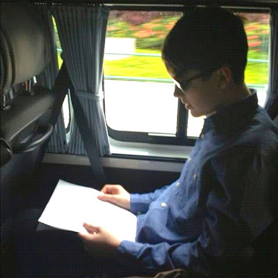Greyson on his way to an interview in his new glasses