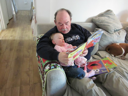 Maddie and Pinkie cuddle up with PaPa for storytime