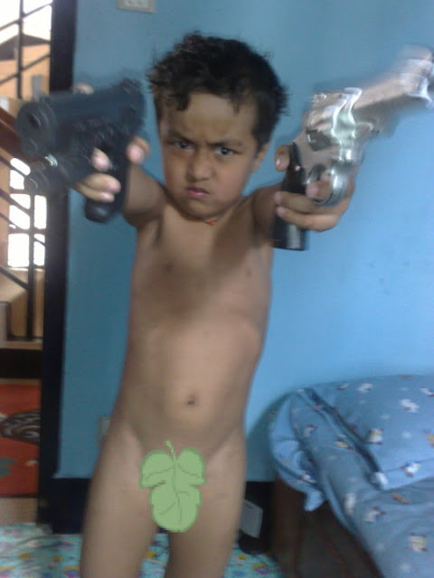 Kid with two guns