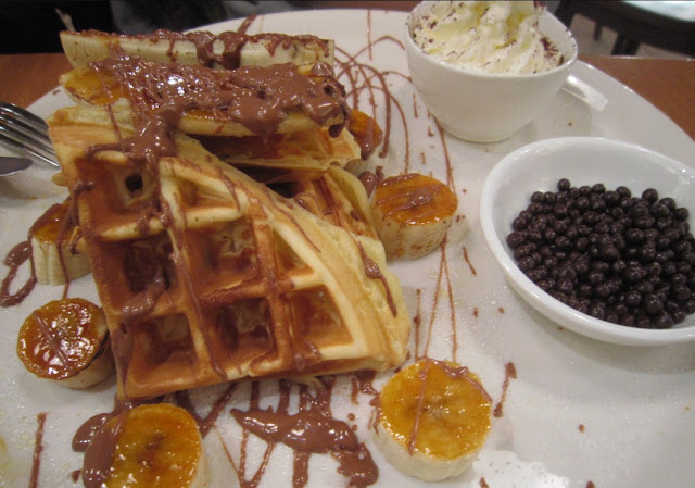 banana waffle with whipped cream. The melted chocolate looks so good ...