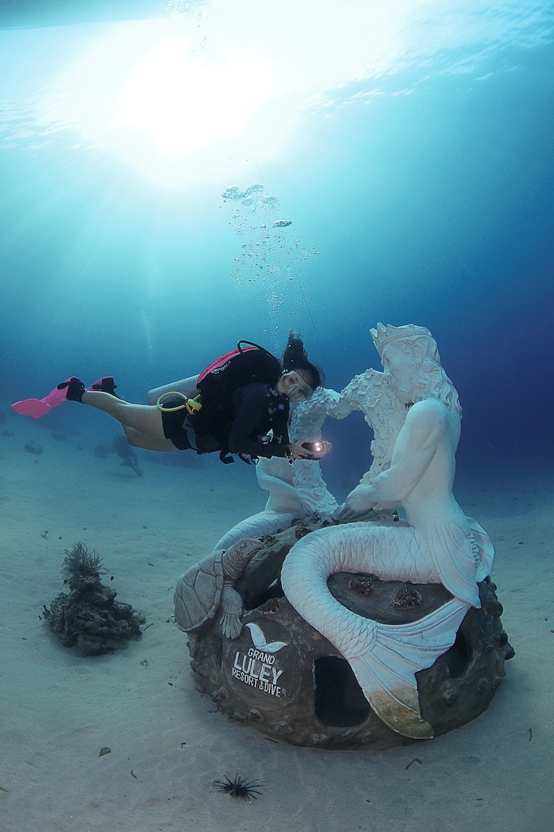 mermaid statue grand luley bunaken