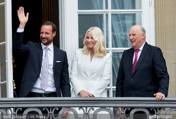 King Harald V of Norway with Crown Prince Haakon of Norway and Crown Princess Mette-Marit of Norway on the balcony at Amalienborg Palace during festivities for the 75th birthday of Queen Margrethe II Of Denmark