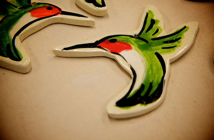 The easiest way to glaze the hummingbirds: 1. Glaze the back and wings green.   2. Glaze the belly white.   3. Glaze the chin red.   4. Finally, outline the bird in black.