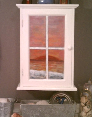 cabinet door window with ocean view