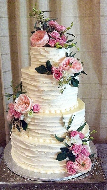 rustic wedding cake with pink flowers