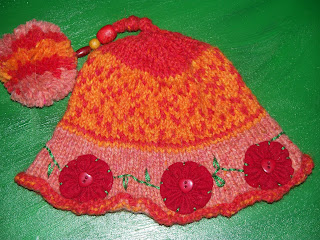 http://www.ravelry.com/projects/needleknack/maureen-odoogans-heartfelt-hat