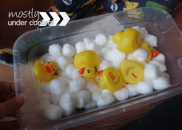 sensory bin with rubber ducks and cotton balls