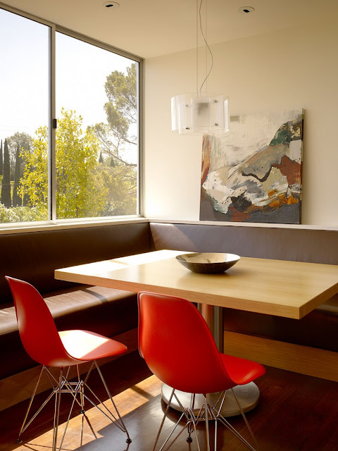 Red Chairs in Home Breakfast Space with Wooden Table and Sectional Brown Wooden Bench