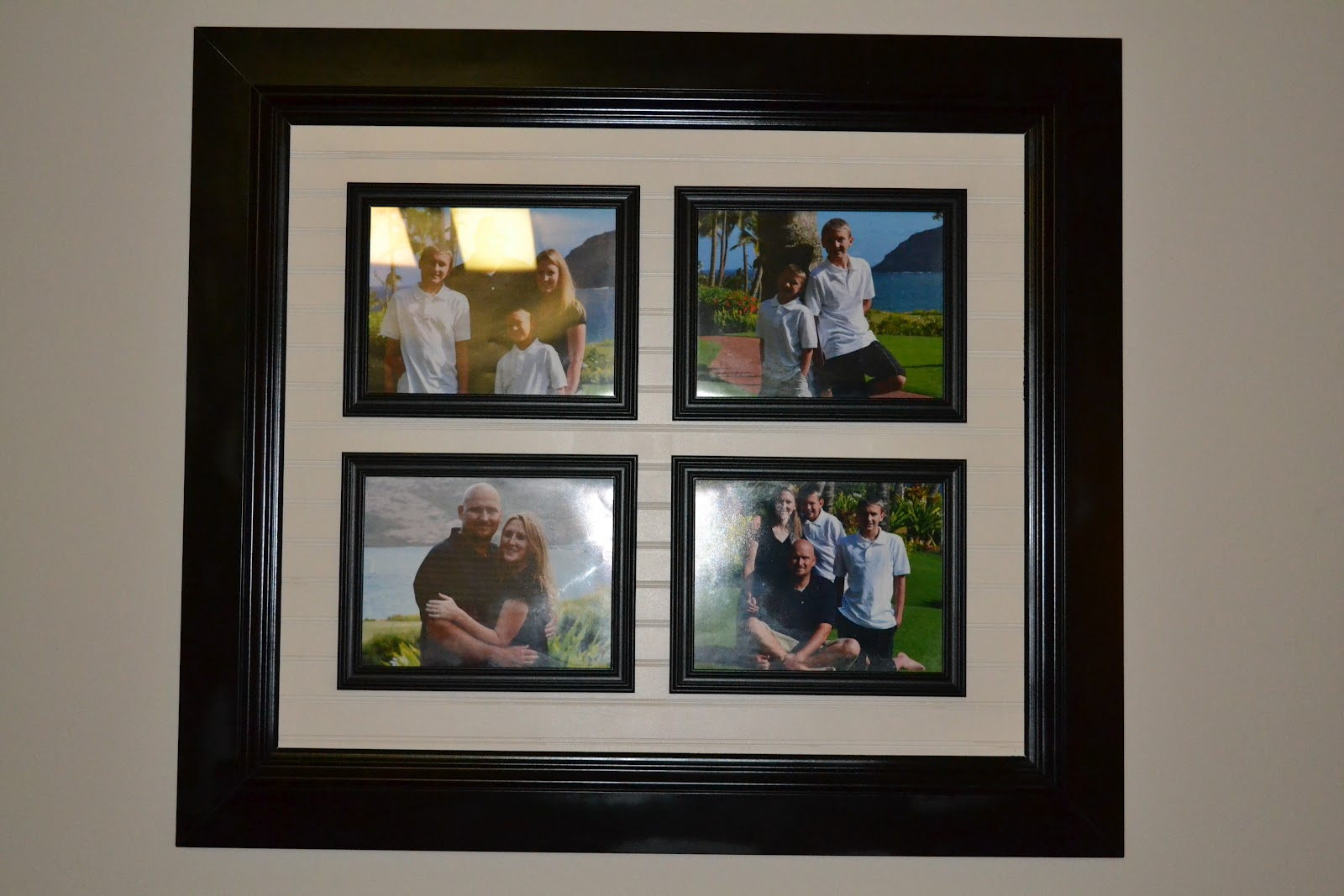 next i got 4 10x14 frames and put the four pictures i wanted in them then i attached the four frames with some removable velcro strips that way i can