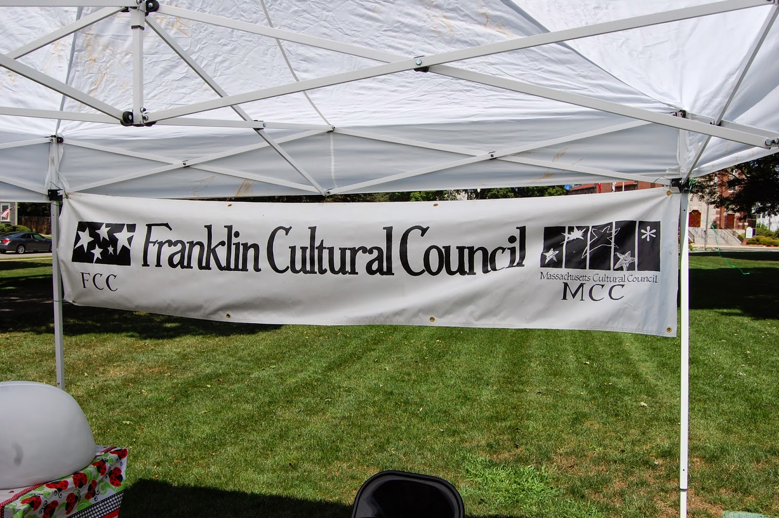 Franklin Cultural Council tent on Town Common when the Ladybug Spots appeared