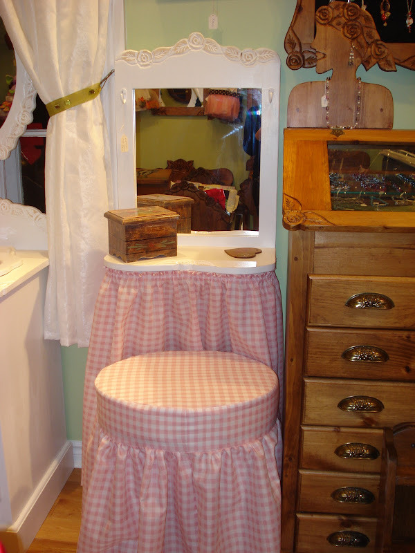 This is a pretty pink dressing table with matching bench. title=