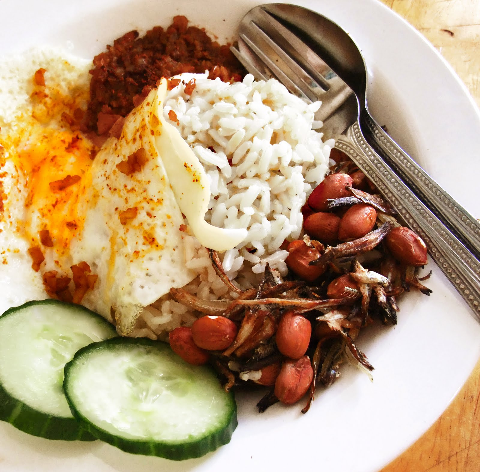 Nasi Lemak (coconut Milk Rice, With Sambal Chilli And Crispy Roasted  Anchovies And Peanuts)