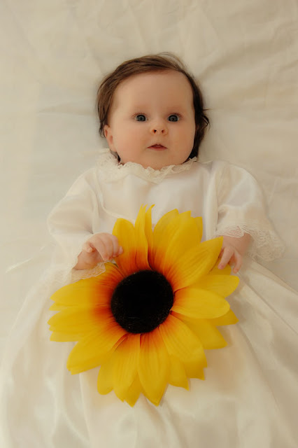 baby with a flower