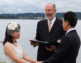 Shanshan and Wei hold hands while Kent Buttars of A Heavenly Ceremony officiates