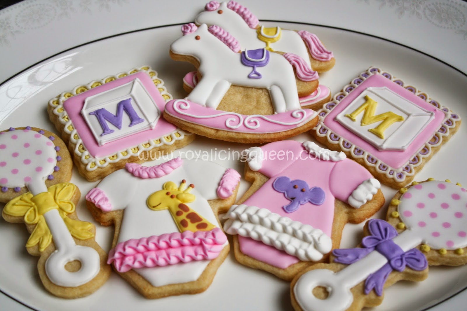 girl baby shower cookies onesies rattles rocking horses and
