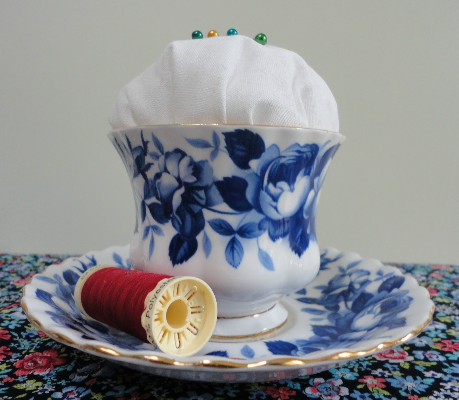 A vintage teacup pincushion