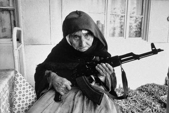 52 photos of women who changed history forever - 106-year old Armenian woman protecting her home with an AK-47. (1990)