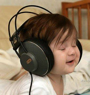 Cute Baby Pictures Enjoying Music in Wallpaper