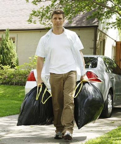 man_carrying_garbage_bags_on_drive_42-17