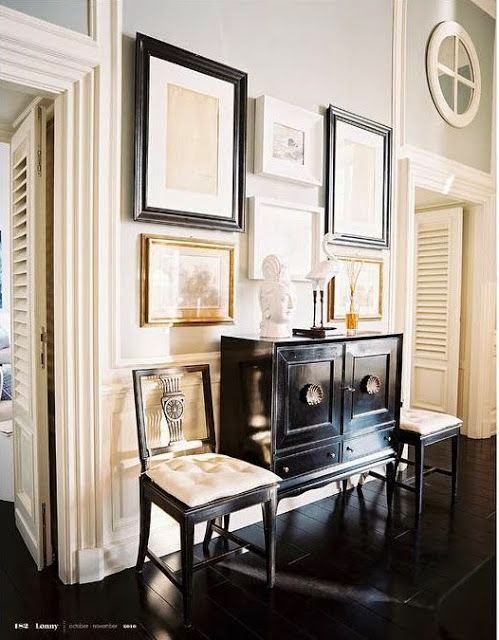 hallway vignette black floors lacquer chest gallery wall