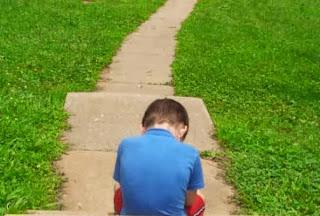 boy alone sitting in love sad