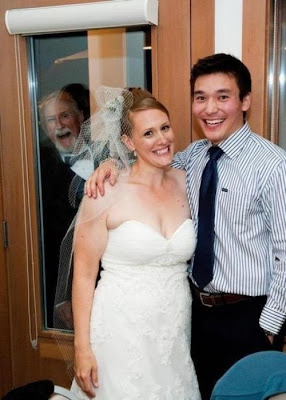 funny wedding picture: grandfather in the background hidden in the closet