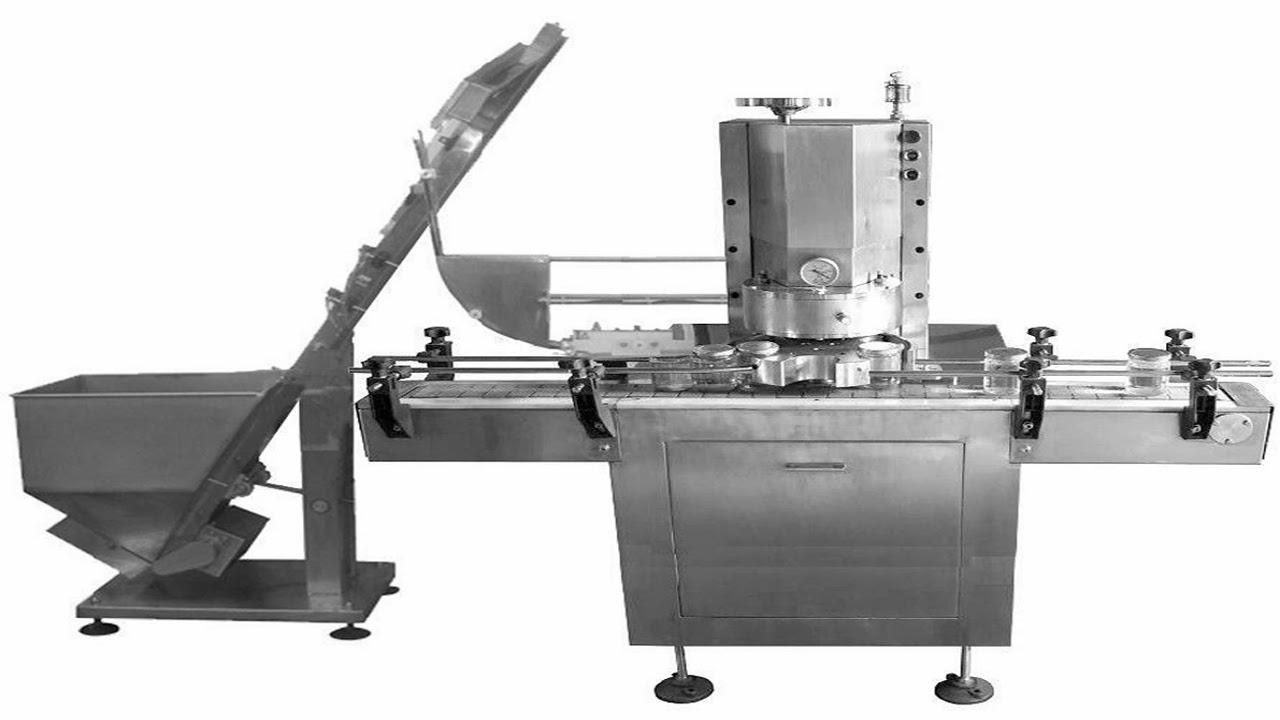 Automatic vacuum capping machine for glass bottles Vacío automático de nivelación de la máquina