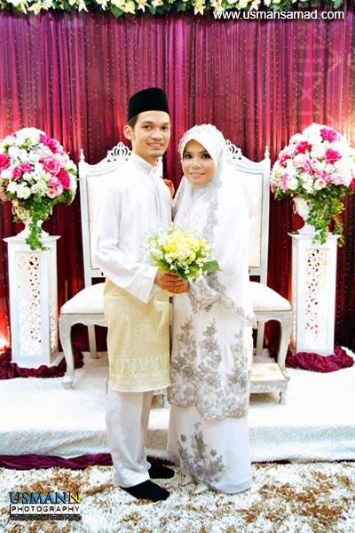 posing bride groom on carpet