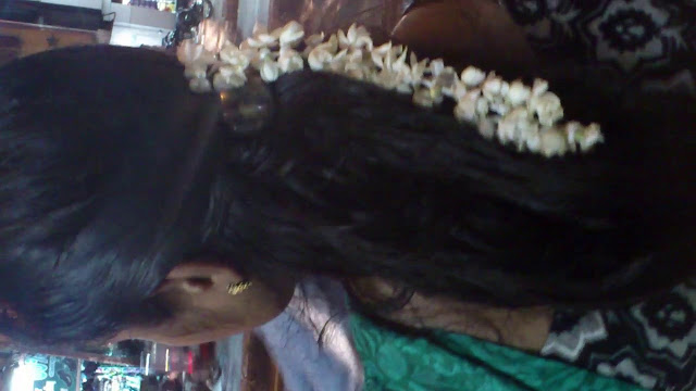 Malayali young girl with long hair.