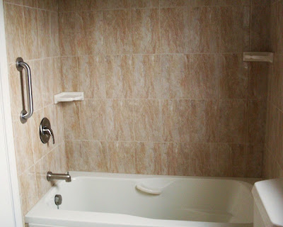 Tub tile surround includes two soap dishes