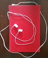 Hardcover book with earbuds.