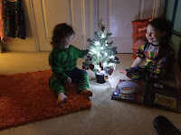 Happy children with their Christmas Tree