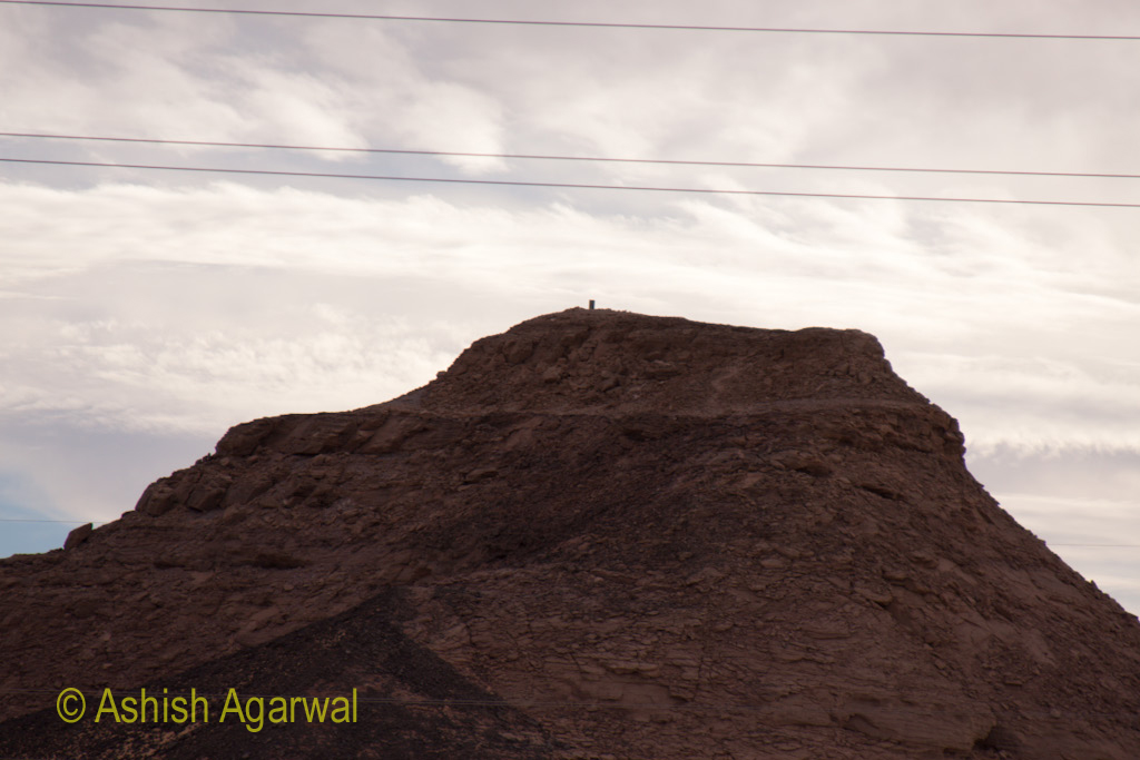 Hillock while on the way from Aswan to Abu Simbel in Egypt with a strong cloud cover