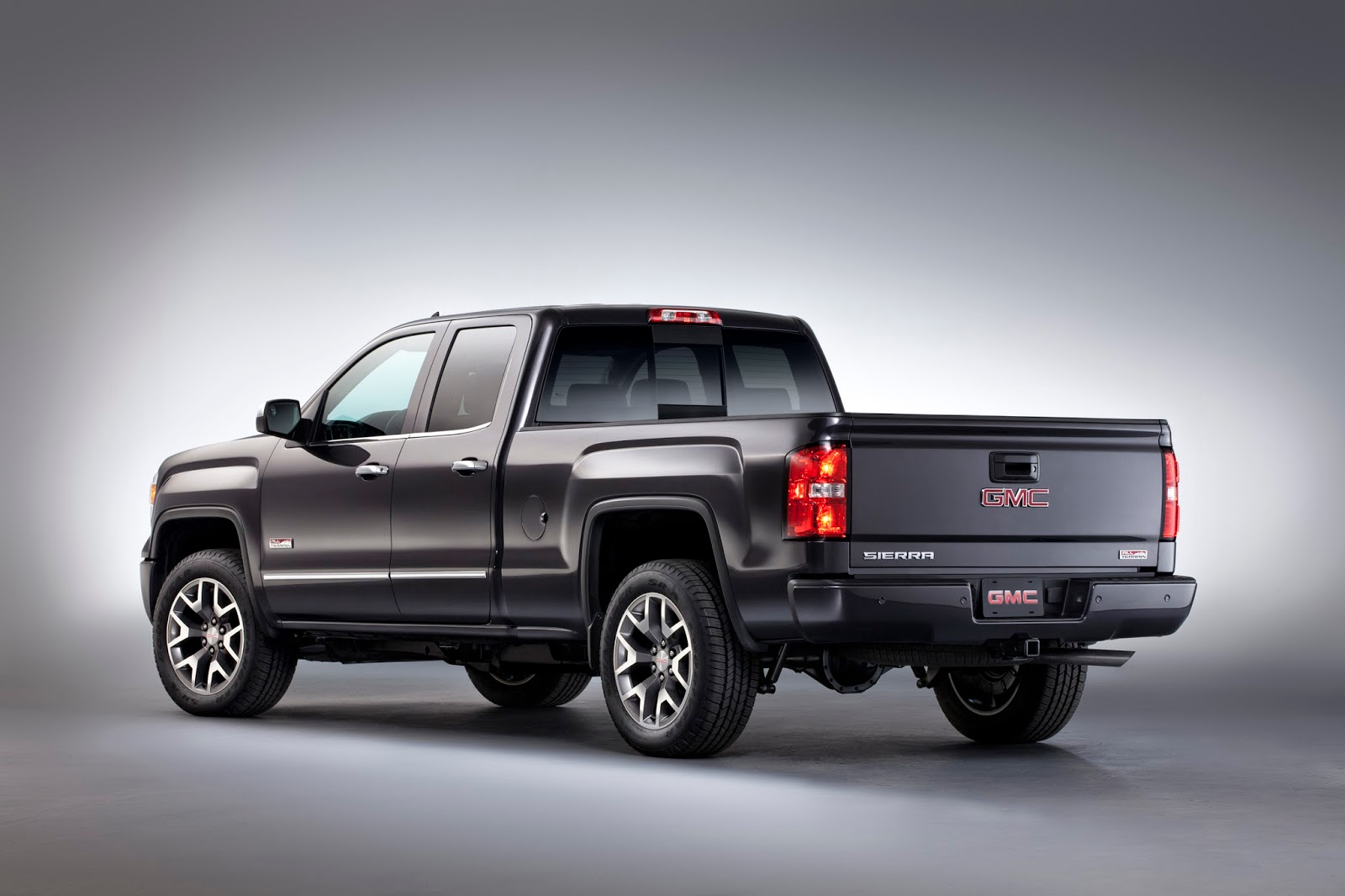 Rear 3/4 view of 2014 GMC Sierra