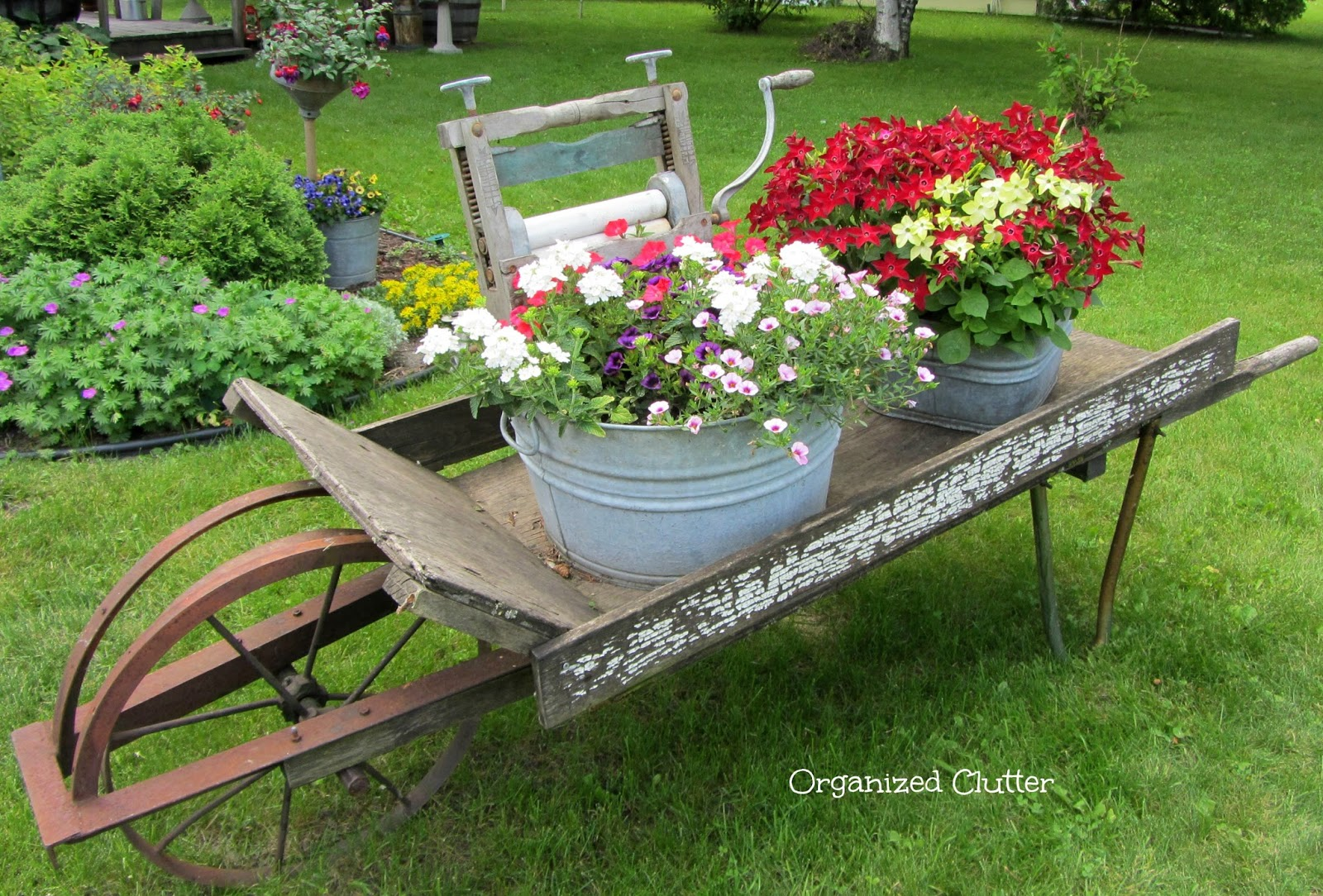 Flower Garden Ideas With Old Wheelbarrow organized clutter: july 2014