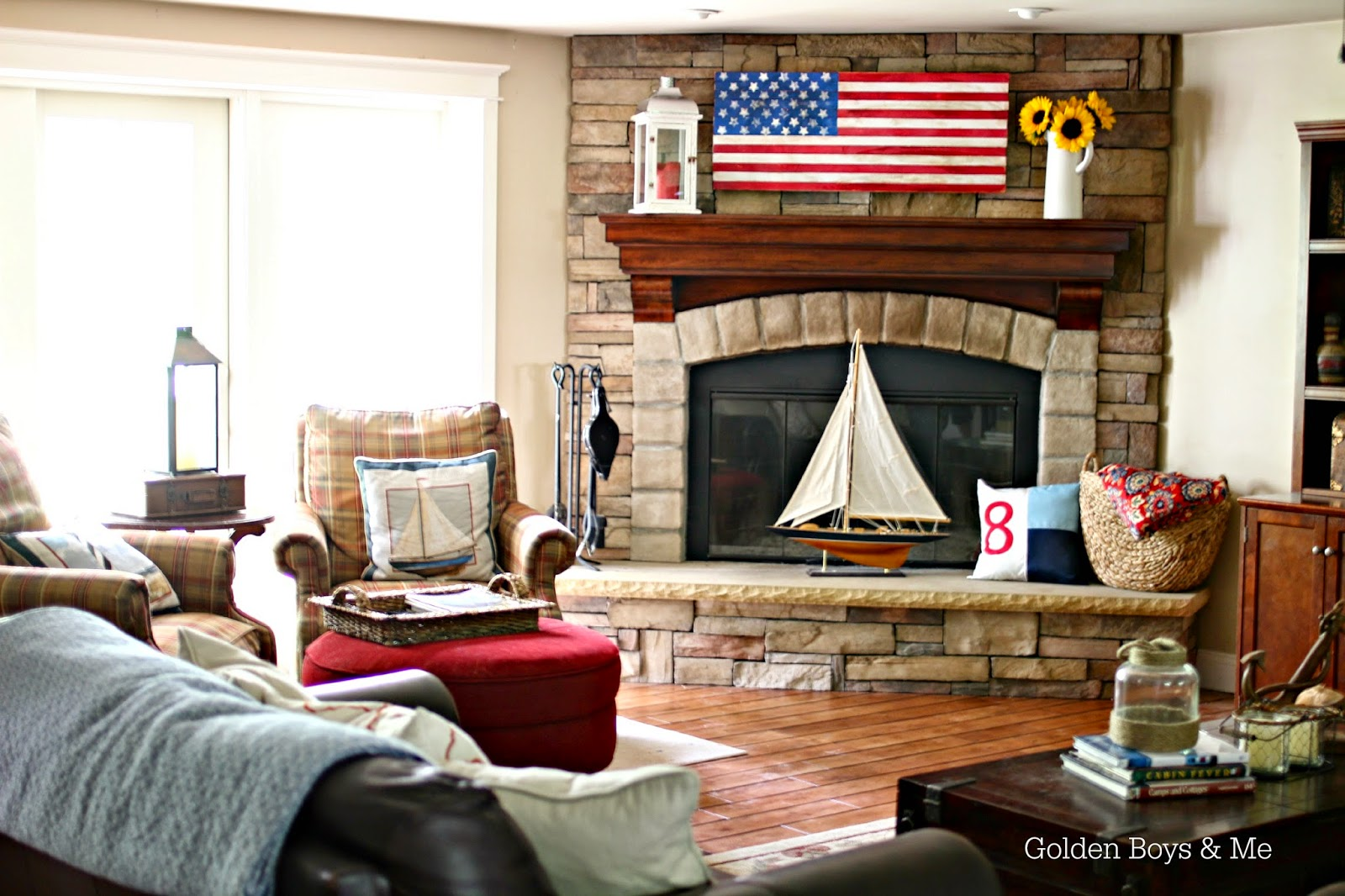 Stone fireplace with diy wood flag in Americana family room-www.goldenboysandme.com