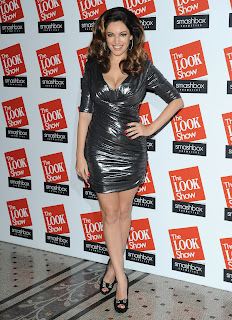 Kelly Brook awearing a retro silver tight dress