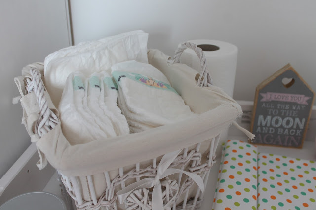 pretty basket containing nappies