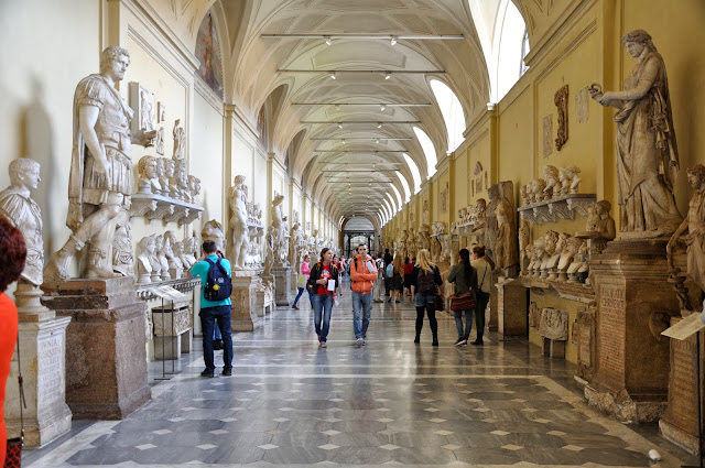 Corridor filled with statues and busts at the Vatican Museum