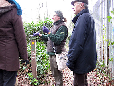 Sarah Adams explaining some woodland features to a group on the Green Chain Walk at Sundridge Park