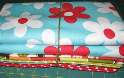 Border, Backing, Binding Fabrics for Red and Aqua Quilt