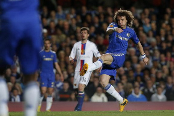 Chelsea player David Luiz shoots to score his side's third goal against Basel
