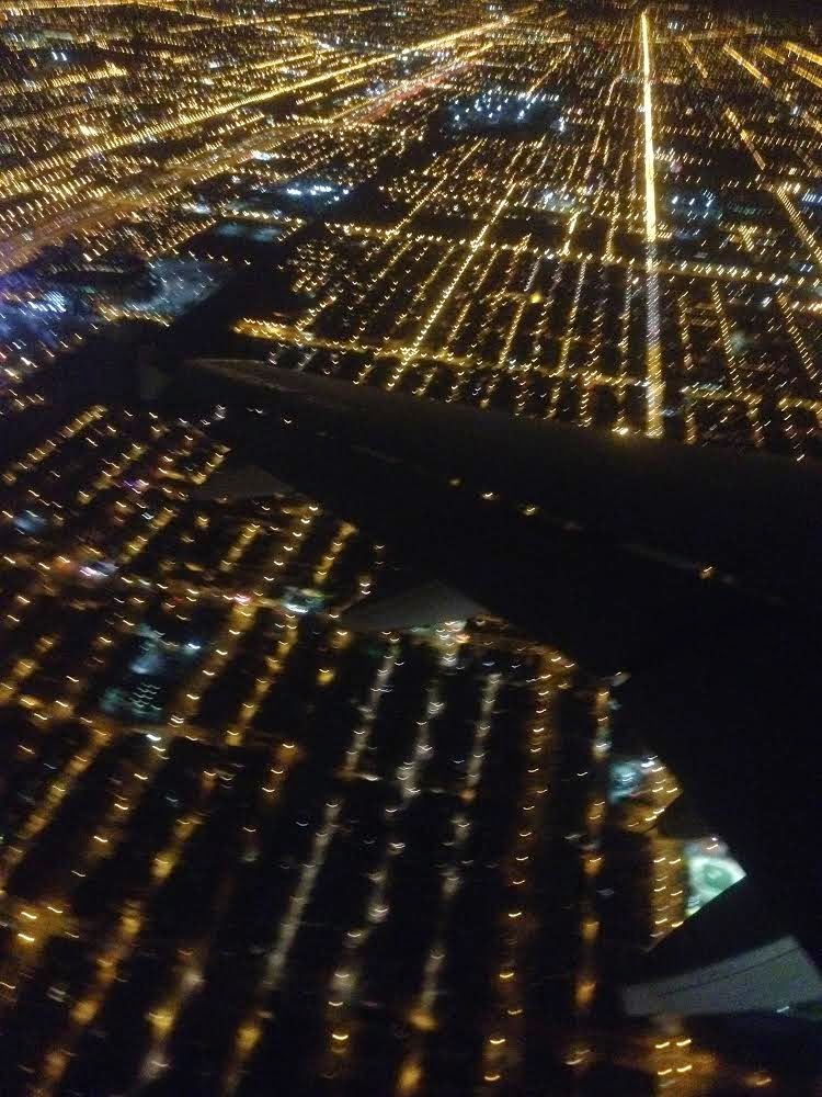 Through a Chicago plane window at night