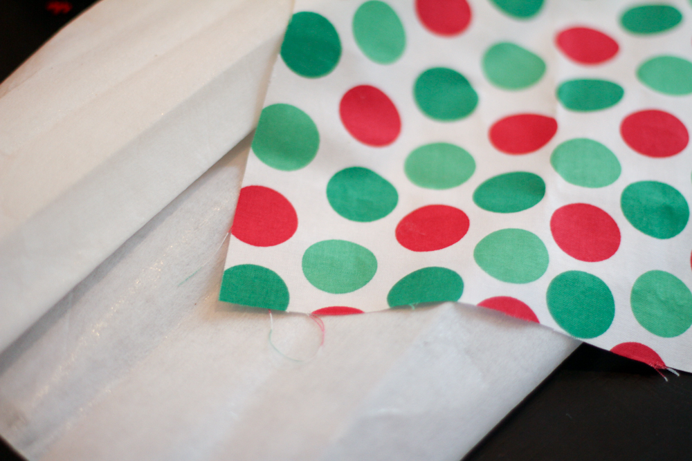 youll start with the fabric of your choice and an iron on adhesive this christmas polka dot fabric is from hobby lobby cut just enough adhesive to cover